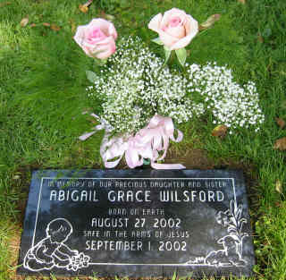 Abigail's headstone with flowers